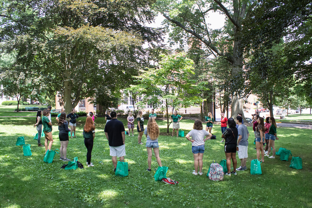 Incoming Ohio University students walk through College Green during Bobcat Student Orientation Monday, June 24, 2019