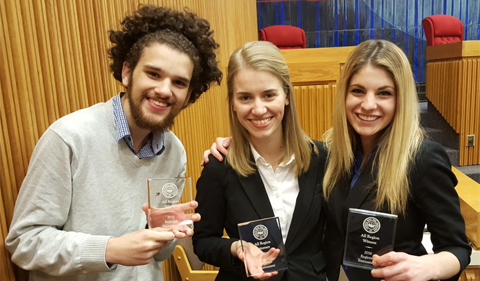 Left to right: Noah Allen, Sarah Welch and Hannah Caldwell smile and pose, waving their awards
