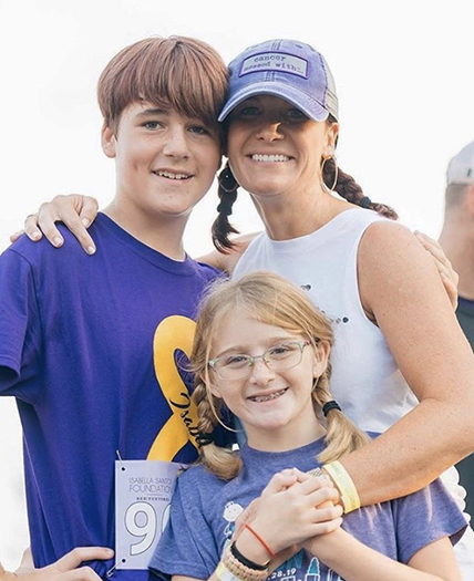 The work of the Isabella Santos Foundation is a family affair for Erin (Myers) Santos, pictured here with her children, Grant and Sophia, at one of the foundation's annual fundraisers.