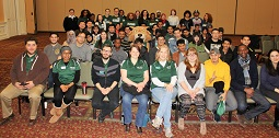 Rufus posed with students at the Jan. 11 international orientation session.