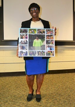 Cecilia Mensah is shown with a memory collage given to her at the special event.
