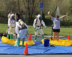 "Collins Career Technical Center students undergo a mock ""decontamination"" as part of Friday's ""No Hazards Here"" critical incident safety simulation, a capstone project in collaboration with Ohio University Southern."