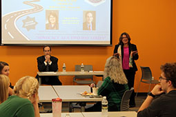 ric Burchard, director of government relations at OHIO, and former Ohio legislator Debbie Phillips speak to a group of OHIO students, faculty and staff.