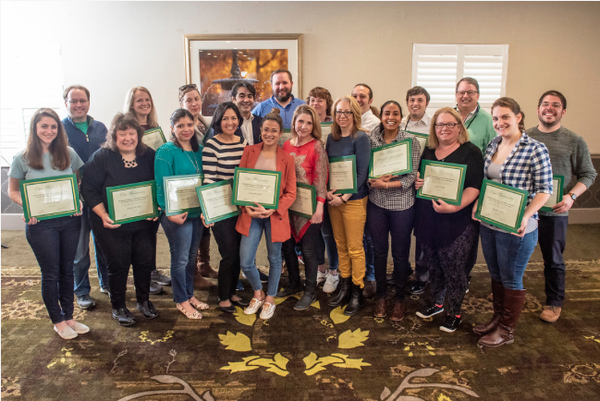 The fellows gather for a group portrait with their certificates of completion, noting the end of their week-long stay in Athens for the Kiplinger Program in Public Affairs Journalism. Photo by Hannah Ruhoff