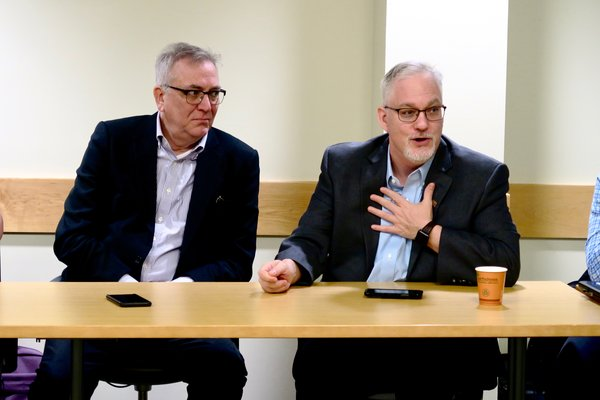 Dr. Scott Titsworth, dean of OHIO's Scripps College of Communication, and Dr. Robert Stewart, director of the E.W. Scripps School of Journalism speak to the fellows.