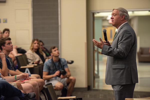 President Nellis introduces Al Letson at the second Challenging Dialogues lecture on April 22.