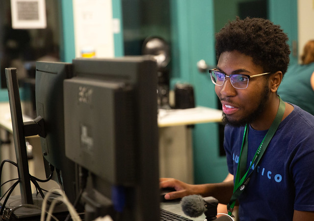 A student works on their track project during the high school journalism workshop. They attended five track sessions to delve into their area of interest. Photo courtesy of the E.W. Scripps School of Journalism