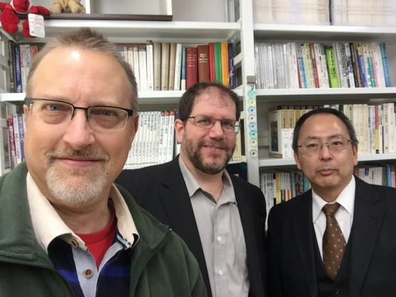 Thompson, King and Yanagi pose for a picture with bookcases behind them