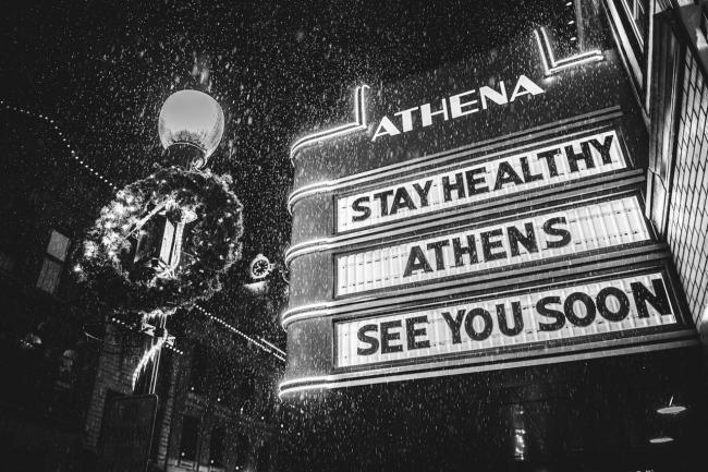 "Athena movie theater sign ""stay healthy athens see you soon"""